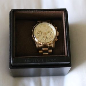 Michael Kors women's Gold watch with extra links